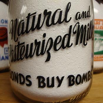 """HANSEN DAIRY...DEER LODGE MONTANA...WAR SLOGAN....""""BONDS BUY BOMBS"""" - Bottles"""