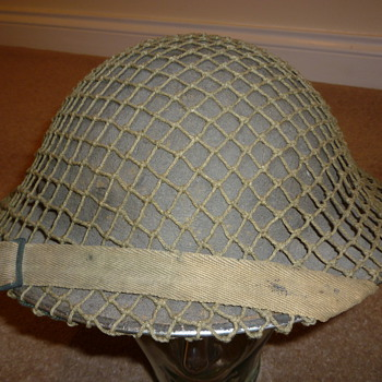 British WW11 helmet with cammo net.