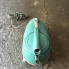 Blue / Green compact vacuum cleaner.