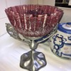 Red Crimmed Glass Bowl on Metal Stand