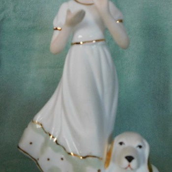White porcelain figurine girl with basset hound (unmarked)