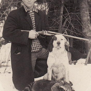 Photograph of Hunter with Shotgun, his dog and dead racoon - Photographs