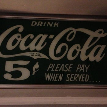 Reverse painted coca-cola 5 cent sign. The glass is what I would consider thin. Found in North Georgia.