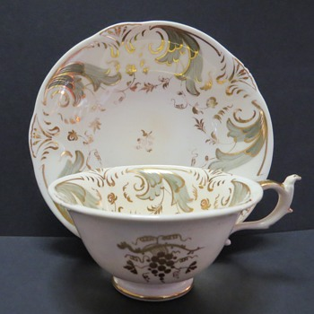 Rockingham Cup and Saucer - Puce Griffon Mark -1212 - China and Dinnerware