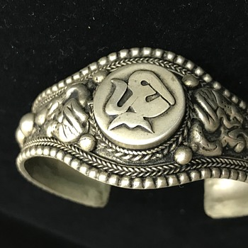 silver cuff bracelet with various symbols - Costume Jewelry
