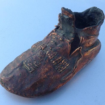 Bronzed Indian baby's moccasin - Advertising