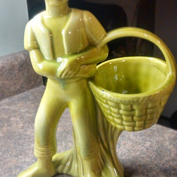 Green mixed glass boy with basket in vase? - Pottery