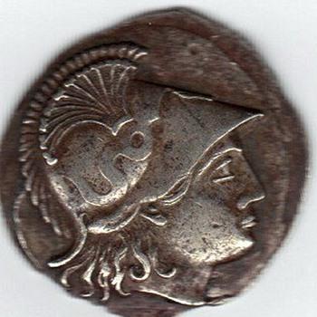 An anciant greek coin perhaps?