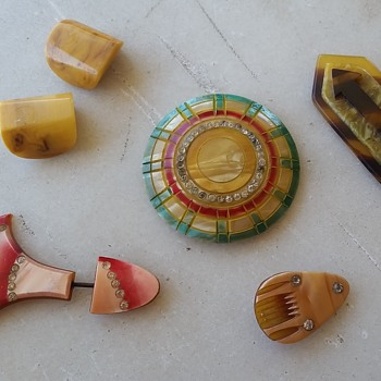 Little celluloid and bakelite pins and belt slides - Costume Jewelry