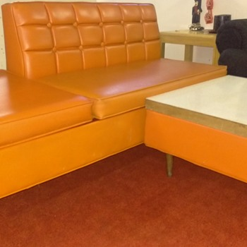 Orange day bed with ottomon
