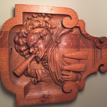 Carving of man drinking beer