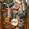 Yard sale find Old Drey Jar with Wood Thread Spools