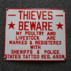 """THIEVES BEWARE"" PORCELAIN SIGN."