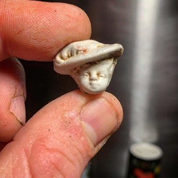 A friend found this while digging on his property. Any ideas ? - Toys