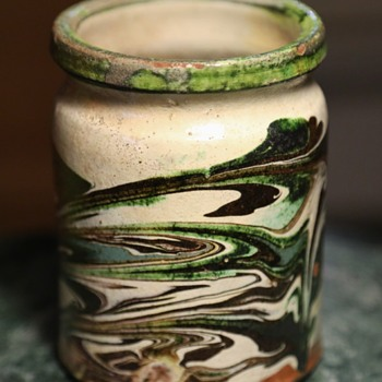 An Old Crock with a Swirled Design - Pottery