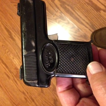 German pressed tin fold out pistol with compass, magnifying glass and mirror (not a cap gun)