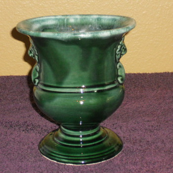 Hull pedestal vase drip brown with lions heads.