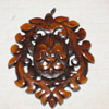 Any history of what this carved wood piece of jewelry is?