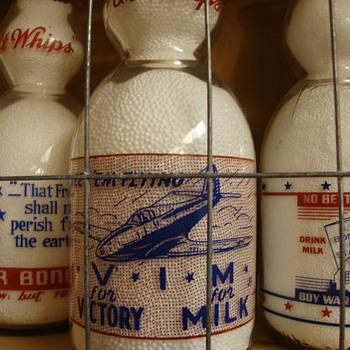 SANITARY DAIRY...WARREN OHIO...CREAMTOP WAR SLOGAN....AIRPLANE - Bottles