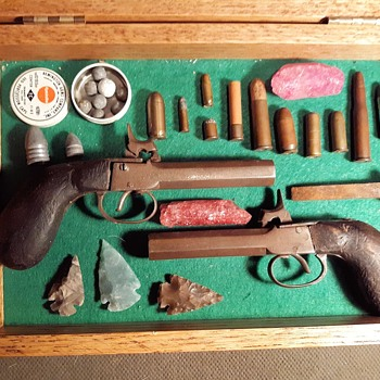 Antique Pistol With Vintage Bullets Arrowheads and This and That - Military and Wartime