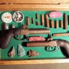 Antique Pistol With Vintage Bullets Arrowheads and This and That