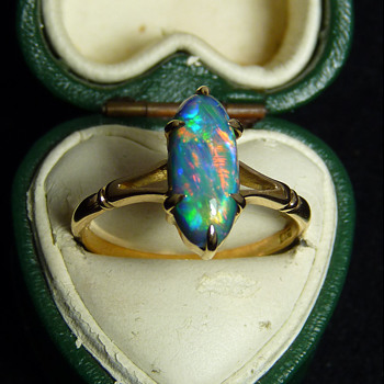 Gem Quality Lightning Ridge Black Opal in an 18ct Gold Ring,  probably circa 1930, and made in Australia