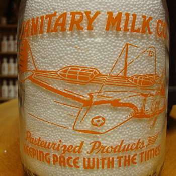 Sanitary Dairy..Rantoul Illinois Quart War Airplane Bottle.... - Bottles