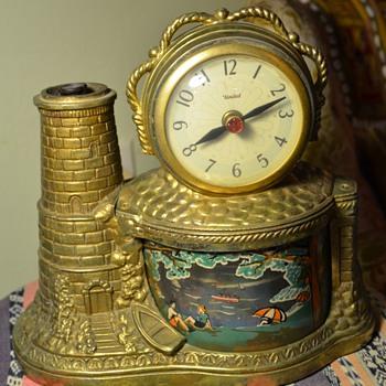 Clock with a rotating beach / lighthouse theme - Clocks