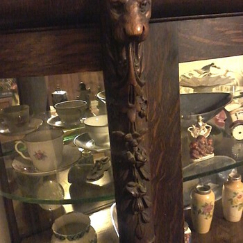 Beautiful curio cabinet has lions head's and claw feet