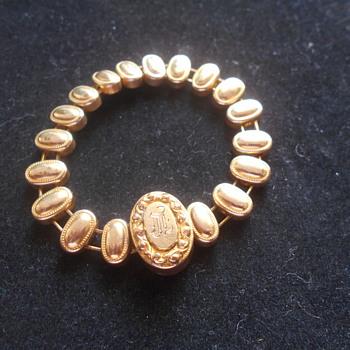 Vintage Childs Initial Goltone bracelet marked Pat. 1906