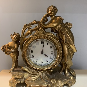 Cast clock with two figures  - Clocks