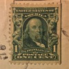 Old US 1-Cent Benjamin Franklin Stamp And On Old POSTCARD