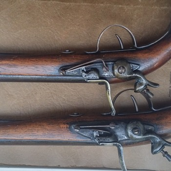 Vintage replica flintlock pistols