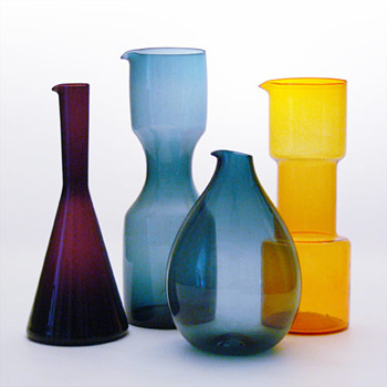 Three jugs designed by Kjell Blomberg for Gullaskruf and a yellow jug by Bo Borgström for Aseda - Art Glass