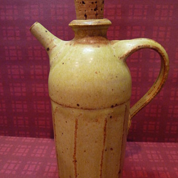 ceramic jug with cork stopper and a spout - Pottery