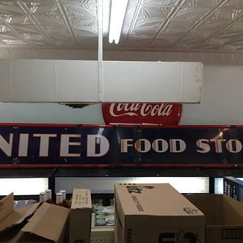 Old porcelain united food store sign