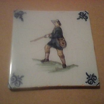 A HUNTER AND SHIP TILES - Pottery