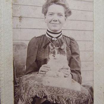 Woman holding her CAT - Animals