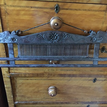 ? Wooden part to a loom antique with carved flowers