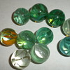 10 Antique greens, blues, and 1 orangish-yellow onionskin marbles