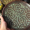 Brown etched pottery wall hanging plate