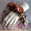 Vintage bakelite and metal pharoah button charm bracelet