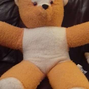 white and bright orange teddy bear