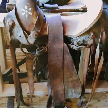 vintage horse saddle I would like to have information on. There's no markings on the saddle other than H.C. in pearl