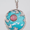 Carved moonstone and guilloché enamel pendant