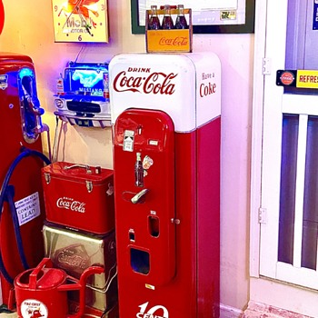1956 VMC 44 coke machine. Restored and keeps the coke bottles ice cold.  - Coca-Cola