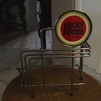 Lucky strike counter display. Not sure what year its from or value of. Any clues?  Got it at a yard sale for 3 bucks.