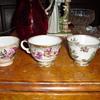 Three flowery tea cups