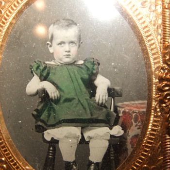 Beautifully tinted ruby ambrotype of boy in a DRESS