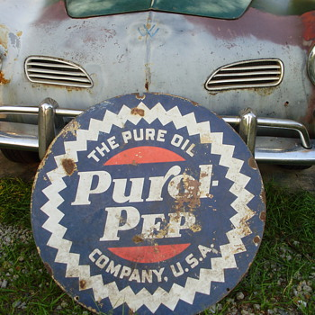 Old oil sign and bicycle. - Signs